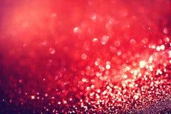 红色假日眨眼睛背景 免版税库存图片