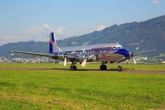 红色公牛道格拉斯DC-6B 库存图片