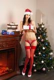 红色内衣的圣诞老人女孩 免版税库存照片