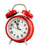 红色减速火箭的闹钟在12点,孤立 库存照片