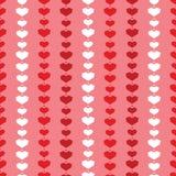 红色几何心脏条纹无缝的样式 图库摄影