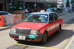 红色出租汽车在香港 免版税库存图片
