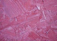 红色刨花板织地不很细背景。 免版税库存图片