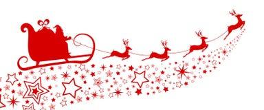 红色剪影 与驯鹿雪橇的圣诞老人飞行在星 免版税库存照片