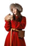 红色卡夫坦长衣的妇女与皮革烧瓶 库存照片