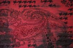 红色印地安patern织品背景 库存照片