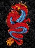 在黑色的红色中国龙纹身花刺 免版税库存图片