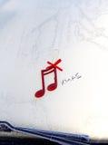 红色发光的装饰圣诞节音乐笔记 库存照片