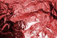 红色发光的金属箔弄皱了纹理作用,褐红的软的起皱纹的背景,欢乐时尚桃红色光滑的背景 免版税图库摄影