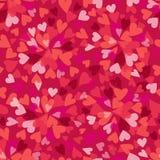 红色和桃红色在明亮的桃红色背景的心脏无缝的样式 免版税库存图片