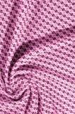 红色和桃红色棉花布料与生动的圈子的样式的和 库存照片