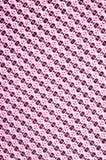 红色和桃红色棉花布料与生动的圈子的样式的和 免版税库存图片