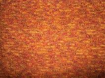 红色和桔子编织了背景的纹理 免版税图库摄影