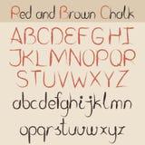 红色和棕色白垩字母表 免版税库存图片
