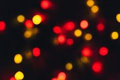 红色和橙色假日bokeh 抽象背景圣诞节 免版税图库摄影