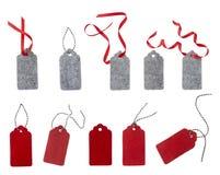 从红色和灰色毛毡的标签 套颜色在白色背景隔绝的礼物标记 库存照片