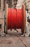 红色和特别卷起的塑料鞘的卷 免版税库存照片