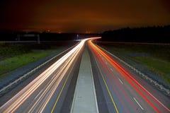 在高速公路的轻的条纹 免版税库存照片