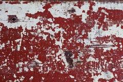 红色和白色困厄的木被绘的纹理 在过时油漆的被绘的纹理 库存图片
