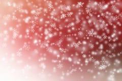 红色和白色圣诞节背景的抽象雪 免版税库存图片