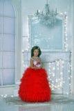 红色和白色礼服身分的年轻公主 库存照片