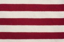 红色和白色镶边织品纹理 库存图片
