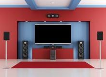 红色和蓝色家庭戏院室 免版税库存照片