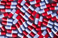 红色和蓝色片剂 免版税库存照片