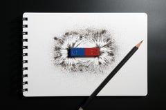红色和蓝色磁铁棒或物理磁性,铅笔和铁战俘 免版税图库摄影