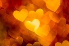 红色和金黄心脏boke照片作为背景的 图库摄影