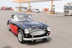 红色和黑奥斯汀Healey 3000 Mk III在利马 免版税库存照片