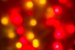 红色和黄色假日bokeh 抽象背景圣诞节 免版税库存图片