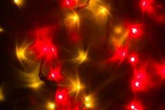 红色和黄色假日bokeh 抽象背景圣诞节 免版税库存照片