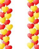 红色和黄色心形的气球背景 库存图片