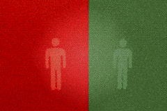 红色和绿色步行标志(使用洗手间) 免版税库存图片