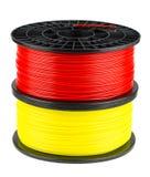 红色和黄色细丝为3d印刷品盘绕 免版税库存图片