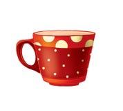 有圆点的陶瓷红色杯子。 免版税库存图片