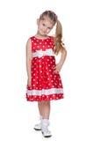 红色圆点礼服的小女孩 免版税库存照片