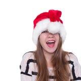 红色圣诞老人帽子的俏丽的妇女 愉快的圣诞节和新年 免版税图库摄影
