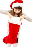 红色圣诞老人帽子的小女孩 免版税库存照片