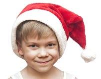 红色圣诞老人帽子的小男孩 免版税图库摄影