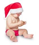 红色圣诞老人帽子的小逗人喜爱的婴孩 库存图片