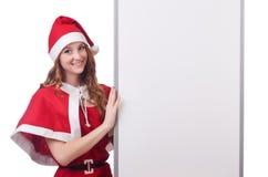 红色圣诞老人服装的少妇 库存图片