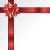 红色圣诞节假日弓和丝带背景 免版税库存照片