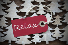红色圣诞节标签与放松 免版税图库摄影