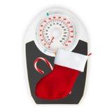 红色圣诞节袜子和标度在白色背景 免版税库存照片