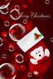 红色圣诞节袜子和肥皂泡 免版税库存图片