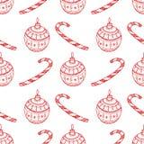 红色圣诞节装饰标志的传染媒介无缝的样式-棒棒糖,树在白色背景的球玩具 图库摄影