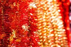 红色圣诞节闪亮金属片 免版税库存图片