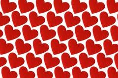 红色在白色背景的毛毡心脏 情人节轻拍 免版税库存照片